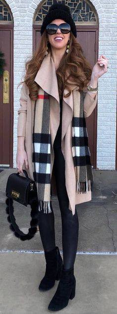 #winter #outfits beige long jacket, black shirt, pants, boots, plaid scarf