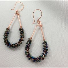"""Iridescent Copper Hoops These are really eye catching hoops. They will go with so many outfits. I made them using copper wire and glass beads. They are just under 2"""" long. Becky Barnes Designs Jewelry Earrings"""
