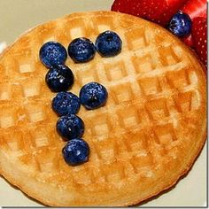 blueberries or raisins, mini marshmallows, etc.) and waffles to teach letters (any language), #s, shapes, or just make a meal special.