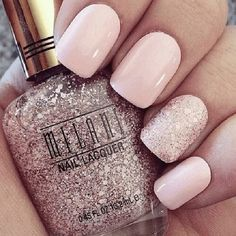 Nude nails are paired with glitter polish on ring finger                                                                                                                                                                                 More