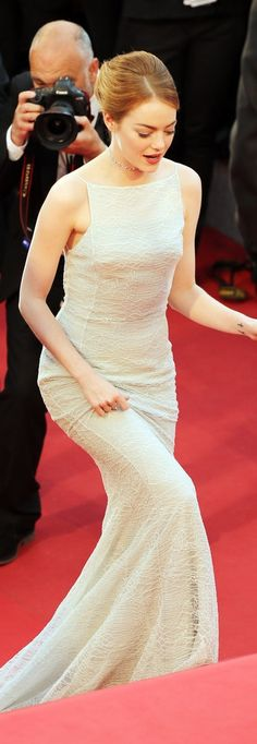 Emma Stone wore a white textured high-neck gown, complete with dainty straps, on the red carpet at the Irrational Man premiere at Cannes. She completed her '90s-inspired look with a shimmering choker necklace.