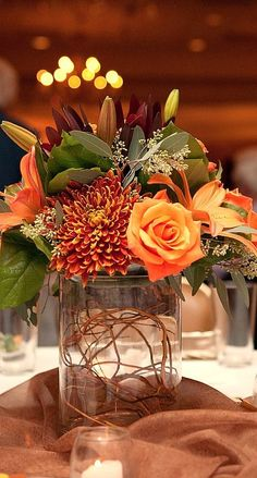 Love the fall floral colours of this centrepiece. #centrepiece http://www.aftershocksinteriordecorating.com