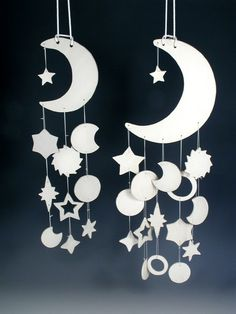 moon mobile... I am thinking of making this n covering with colorful glitter or some wallpaper
