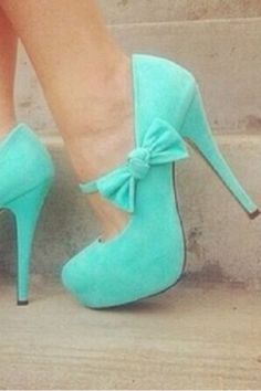 Turquoise shoes. My favorite color right now! Colour's fine but I hate seeing women damage themselves and struggle to walk comfortably because they think men like heels. They are akin to foot binding.