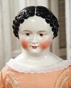 View Catalog Item - Theriault's Antique Doll Auctions  Large German Porcelain Doll with Rare Brown Eyes and Painted Lashes