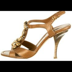 Miu miu stunning shoes Golden embellishment and brown leather shoes with golden 4 inch heels. Super comfy in MINT condition Miu Miu Shoes