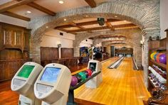 A two-lane bowling alley and authentic arcade games highlight the game room of this elegant luxury home in Rancho Santa Fe, Calif. Home Bowling Alley, Million Dollar Rooms, Arcade Room, At Home Movie Theater, Theater Rooms, Game Room Design, Mansions Homes, Inside Mansions, Home Movies