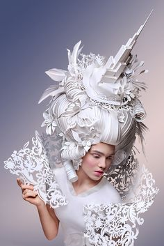 asya kozina designs intricate head ornaments with a puzzle of carefully cut paper shapes   all images by anastasia andreeva
