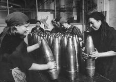 Soviet workers greasing artillery shells prior to packing them for the front, 1940