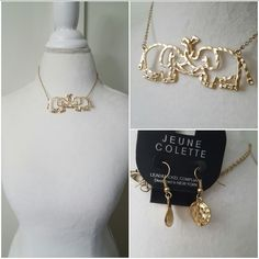 """Gold necklace with 2 elephants with intertwined trunks. Gold earrings are stamped discs. Necklace is 18"""" plus extension. Earrings are 1.25"""" drop."""