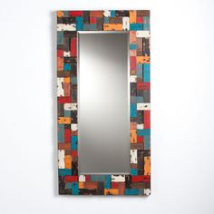 This Upton Home decorative mirror features an assortment of multicolor painted blocks to create an artsy vibe. This chic, eclectic mirror hangs vertically or horizontally for a custom look in any room and blends with a variety of styles.