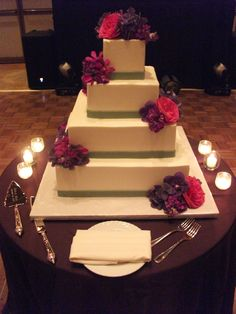 Purple and pink accents on this cake...change the ribbons and add piping