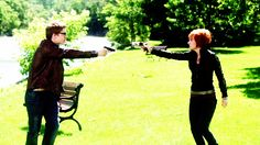 Claudia and Todd holding each other at gunpoint... How cute :)