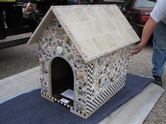 Mosaic tiled a dog house once and that will suffice.