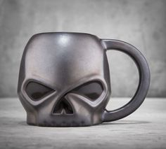 Not a morning person? We're pretty sure no one will bother you when you drink your coffee from our Sculpted Skull Mug. It holds  15 oz. of attitude to take on whatever the day throws your way.