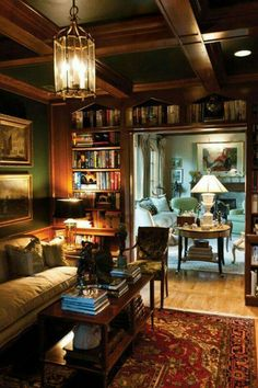 Oh ... my ... gosh ... This is where I want to live. The wood bookshelves, the green paint, red rug--all create the ambiance I'm trying to create.