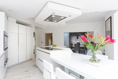 The long island creates a main focal point to the kitchen Slg, Corian, Long Island, Lotus, Kitchen Ideas, Table, Furniture, Home Decor, Lotus Flower