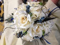 bride's bouquet...notie the peacock feathers...we shipped this wedding to Arizona.