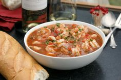 Shrimp Fra Diavolo Recipe Main Dishes with large shrimp, shells, kosher salt, whole peeled tomatoes, vegetable oil, dry white wine, garlic, dried basil, crushed red pepper flakes, dried oregano, anchovies, fresh parsley, pepperoncini