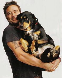 """Jeffrey Dean Morgan & Bisou """"I was walking in Venice Beach and some kids had two litters of puppies, 2-3 days old, in a box. She was at the very bottom and couldn't open her eyes yet. They said 'gimme 300 dollars!' and I was like 'I got 20 bucks on me. Give me the one that's not gonna make it through the day.'  I took her to the vet and he was like 'I don't know, man. She's too young, she shouldn't be away from her mom.' So I bottle-fed her for a month and 12 years later, here she is."""""""