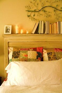 Was just talking over this idea the other day. An old mantle as a headboard. Not sure if that's what this is but it looks like it.