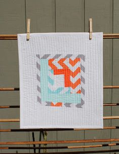 scrappy improv mini quilt wall hanging by Heather Jones for Riley Blake Designs. Tutorial at http://www.rileyblakedesigns.com/blog/2012/09/26/project-design-team-wednesdayscrappy-improv-wall-h/