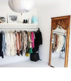 MAJOR closet organization inspiration. Love the gold leaner mirror.
