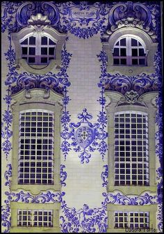 I love the curvature of the windows above and the sculted frames.  Also love the painted blue walls: Portugal