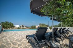 Right next to the private outdoor terrace, you will find the pool deck of Casa Magnifica Vacation Homes For Rent, Naxos Greece, Luxury Villa, Beautiful Islands, Sun Lounger, Terrace, Deck, Outdoor Decor, Holiday