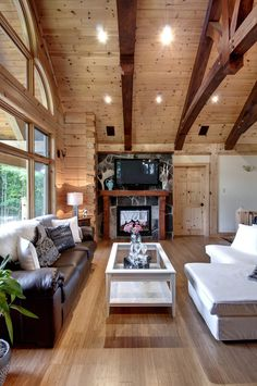 The dark timber beams play wonderfully against the lighter wood ceilings, along with the TV and fireplace framed with their stone backing.