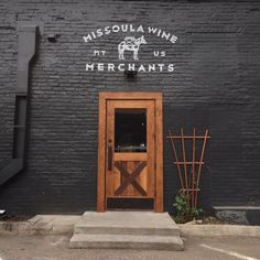 Missoula Wine Merchants in Downtown Missoula - Breweries, Wineries, and Distilleries in Missoula - Restaurant Signage Design, Facade Design, Brick Store, Black Building, Malbec, Shop Facade, Black Brick, Coffee Shop Design, Shop Fronts