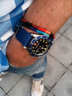 """Bernhard's """"play watch"""". Vintage Rolex GMT with black face, blue dial and red second hand. Nice bit of personalization."""