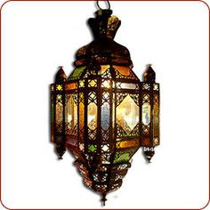 The Moroccan hanging lamp version of the Koutshi lanterns. Glass fitting within an aged metal frame, finished with mat lacquer for protection. A small hinged locking door allows access within. Moroccan Lighting, Moroccan Lamp, Moroccan Lanterns, Foyer Pendant Lighting, Small Hinges, Yellow Houses, Lantern Lamp, Garden Inspiration, Lights