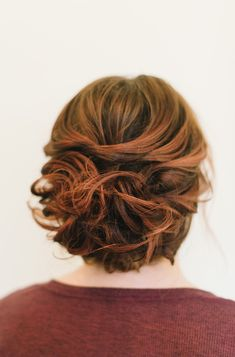 Short Hair Updo: This low, messy updo is the perfect style for someone with shoulder length hair or shorter. The way it is pinned makes it look longer than it is. CreditsPhotographers: Sarah McKenzie PhotographyHost: Adorne ArtistryWorkshop Instructor: Hair & Makeup by Steph