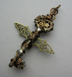 Bat Winged Steampunk Key Pendant -- Wire Wrapped Antique Key with Gears, Brass Wire (A Key to Time). $65.00, via Etsy.