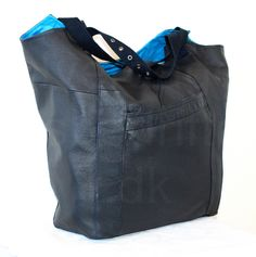 A huge bag sewn of a repurposed leather jacket.
