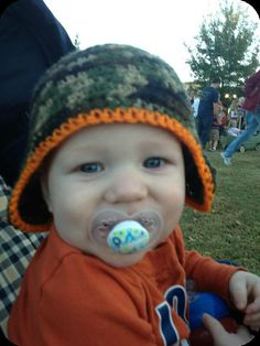 Crochet Camouflage and Orange Hat/Photography prop. $13.50  https://www.etsy.com/listing/115263292/crochet-camo-and-hunters-orange