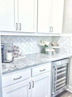 The backsplash is Daltile m313 contempo white marble 3×6 tile laid on herringbone.: