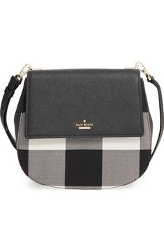 Crisp buffalo plaid intensifies the vintage character of this structured crossbody bag by Kate Spade trimmed with glazed, crosshatched leather.