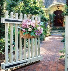 Love the basket of flowers on the gate