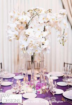 Draping orchids make a perfect simplistic centerpiece for a wedding reception. So glamorous! #glamwedding