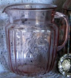 open rose depression glass pitcher