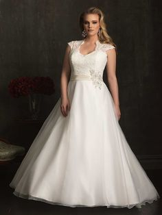 Allure wedding gown: This dress is on its way for our Curvy Couture Boutique. If you are a bride size 16-30w we have hundreds of dresses for you to try like this and more. Discover why brides come from all over to feel comfortable and to find there dream dress.