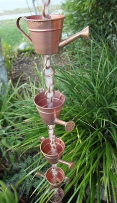 """Watering Can Rain Chain - Rain chains are a beautiful alternative to traditional downspouts. They guide water visibly downward to the ground. This is known as an """"open"""" water flow system. Rain chains also sound great!"""