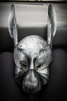 I will make a leather mask of Sheet Metal Rabbit - very similar to my first work (photos). Light and solid. Good materials, very laborious finish. My prototype was made with easy to hide, thick elastic band, as a holder, but we can discuss about another option. Colors and the mask expression (of face) can be customized. I put felt or soft leather inside for your comfort.  Dimensions - about 40cm (16 inches) height (on one of photos with fake leather tie, which you can order too - in another…