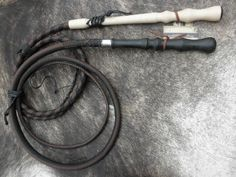 Conlaoch's bull whip.  Much like the black handled one, but twice the length (20 feet).  The illustration should include two of them, as he fights with one in each hand.