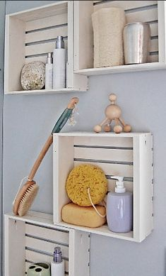 Wooden crates added to the wall as a DIY bathroom shelf...great for a beach/seaside theme