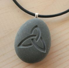 Celtic triquetra necklace - Tiny PebbleGlyph (C) pendant - engraved beach stone via Etsy
