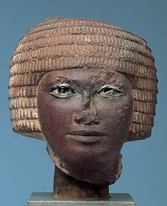 This head comes from a statue which stood in the tomb of the man represented. It has been executed in the extremely hard stone, quartzite, and the eyes are in the even harder stone, quartz. In the tomb the statue assumed the role of the dead person himself.  2448 BC h150 mm Red quartzite, steatite, Ivory and quartz