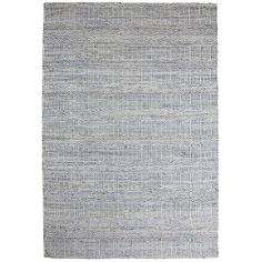 The same durability that makes denim a favorite clothing material makes it ideal for our handmade rug. Crafted of reclaimed denim and wool, our floor covering is hand-tufted for comfort with a chic washed appearance and variegated stripes ranging from indigo to light blue. It's the perfect fit for any space.